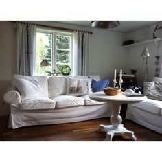 Our farmhouse livingroom. White Ektorp sofas, vintage trunks and an old table that I've painted.