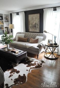 living room - paint color + curtains + bookcases + sofa + ottoman  Cowhide  Rug ...