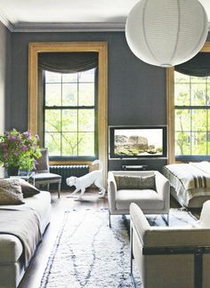 the natural wood trim keeps the grey from being too cold. the accents of black lend to the depth as well.