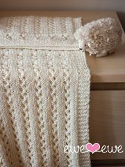 A simple lace stitch makes this an heirloom blanket, and the wooly worsted yarn makes it easy to care for