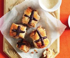 A super fast and easy recipe for classic hot cross scones with the distinctive chocolate cross on top.