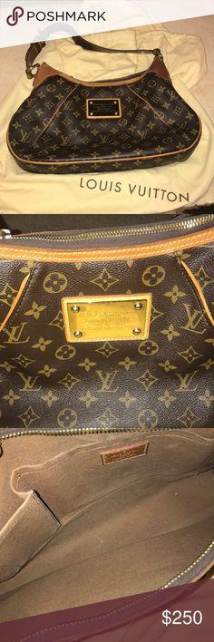 Louis Vuitton Shoulder Bag One strap shoulder bag. Has 2 pockets on inside. Louis Vuitton Bags Shoulder Bags