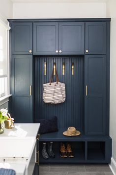 Dark blue mudroom bench with cabinets and beadboard trim finished with brass pulls and hooks for accessories. Mudroom Cabinets, Mudroom Laundry Room, Laundry Room Design, Bench Mudroom, Entryway Cabinet, Cabinet Hardware, Küchen Design, House Design, Interior Design