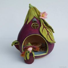 Goard painted like eggplant and decorated with felt.