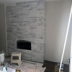 From herringbone marble patterns to ceramic subway and mosaic, discover the top 60 best fireplace tile ideas. Explore luxury interior designs for your home. Beach Fireplace, Fireplace Facing, Fireplace Tile Surround, Fireplace Wall, Fireplace Surrounds, Fireplace Design, Fireplace Ideas, Modern Fireplace, Fire Surround
