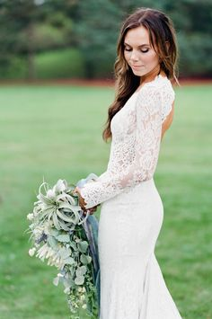 This dress is absolutely gorgeous to me. I want something like this when I get married. Love all the lace and the back of it a lot.