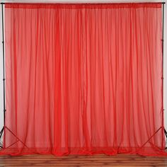 10ft x 10ft Sheer Organza Curtain Panel - Red |  Sheer, stylish, and extremely elegant; this sheer Voil curtain panel can be hung by itself to add charm to any place or can be coordinated with additional panels for a luxurious layered effect. Hang these delicate curtain panels from any standard size curtain rod and see how the flawless sheerness of soft Voil material coupled with lush cascading layers add an ethereal touch of elegance to your home or party space. These voguish Voil curtain…