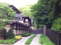 Boynton House. 1908. Rochester, New York. Prairie Style. Frank Lloyd Wright. Foreground left is a newly built pergola and garage (not by Wright.)