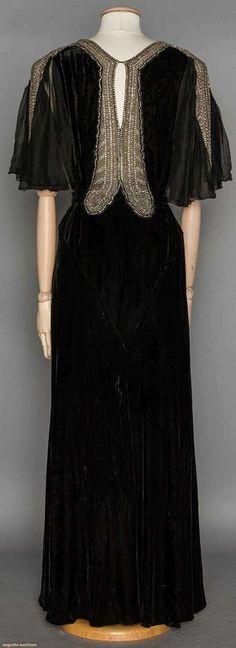 RHINESTONE TRIMMED EVENING GOWN, 1930's | Black silk velvet, chiffon flutter short sleeves, key-hole back, silver metallic w/ rhinestone neck & sleeve trim (back view)