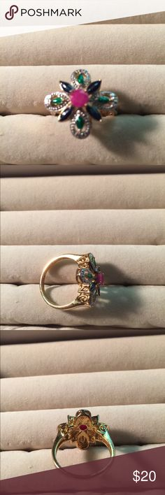 Ring size 9 14K Gold Plated. Ring has never been worn. Beautiful colors. Ring was purchased about 1 1/2 - 2 years ago. Picture does no justice. Jewelry Rings