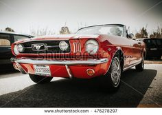 MALAGA, SPAIN - JULY 30, 2016: 1966 Ford Mustang front view in red color, parked in Malaga, Spain.