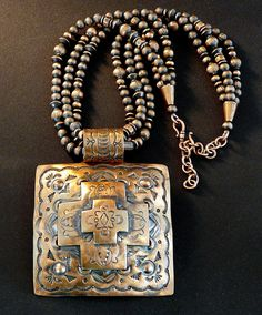 This outstanding Necklace features a Native American-made Stamped Copper Pendant with 3 layers of metal and oxidized detail. The Pendant is 3-inches square, with a small center Four Corners Cross set