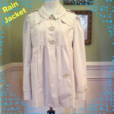Cute BabyDoll Style Rain/Wind Jacket Simply Darling!!!  BabyDoll style rain/windbreaker jacket!!!  Great color of Beige will go with everything!!!  3 Large front buttons for closure, cute rounded collar, gathered shoulders with button hook detail. Also offers front pockets and the sleeves are adjustable to suit your need. Light weigh and fully lined!!!  Great jacket for the $$$. Priced to sell!!! Dereon Jackets & Coats