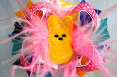 Fun bow that is perfect for the upcoming Easter Season.  Bow measures 4.75 inches acrossed and has everything you can imagine in a bow. From...