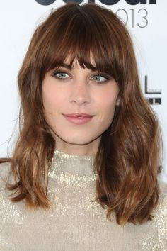 Blunt Fringe When you thin out a fringe for thick wavy hair, you are getting frizz on a humid day, even if you have straighten your fringe meticulously before going out. Blunt cut bangs are heavier, so they look better in any weather. Alexa Chung has thick wavy hair, and this is the reason why she always wears her bangs cut blunt.
