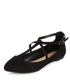 - Cross strap detail- Pointed toe- Flat heel
