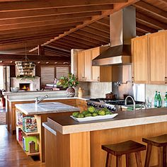 Teak cabinets (holds up well in wet and humid conditions), white calcutta luna marble and limestone countertops.