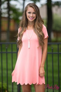 This dress will make you wish springtime was forever! The coral color paired with the scalloped details on the sleeves and bottom hemline is so soft and feminine, while the lightweight material is great for warm spring and summer days.