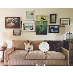 Photo wall over loveseat.