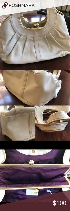 Coach Ergo Cream and gold Coach shoulder bag. Has purple satin lining, with three large inside compartments. Three pen parks on the back of bag, as shown in pictures. Used a handful of times. Smoke free home. If you have any questions or want more pictures please just ask! Coach Bags Shoulder Bags