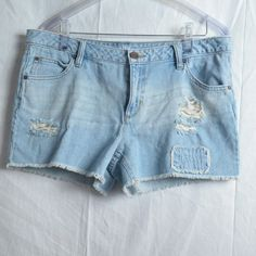 A.N.A. Size 12 Destroyed Jean Shorts This is an adorable pair of jean shorts from A.N.A. that are light blue and have the destroyed look.  They have a rip on each side of the legs as well as a patch on the left front. These are 100% cotton and stretchy and are size 12. #a.n.a. #destroyed #jeanshorts #size12 #cotton #stretchy a.n.a Shorts Jean Shorts