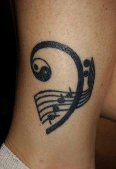Bass Clef tattoo on my leg I got in L.A. drawn by an artist friend.