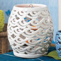 Waves Hurricane by PartyLite® - The shape of a trendy garden stool takes on a clever candle holder size! Pierced ceramic in a glossy white glaze that will span the seasons.