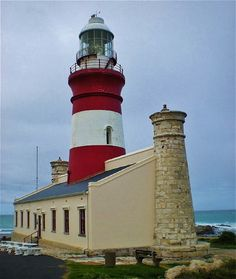 Cape Agulhas Lighthouse in the Western Cape Province, the most southern point of South Africa. Provinces Of South Africa, Beacon Of Light, Out Of Africa, Light Of The World, Cape Town, Lighthouse, Places To Go, Windmills, Beautiful Places