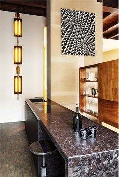 Modern kitchen with marble countertop and neon light fixtures // Vincenzo De Cotiis Interior Design