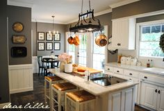 I love the 20 x 20 slate floor tiles and the wall color in this kitchen by Dear Lillie
