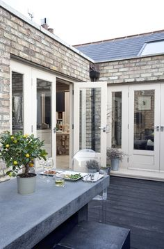 Charcoal deck colour  - William Morris interior design; French doors; Gardenista