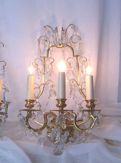 Vintage French Brass and Crystal Sconces by sheriscrystals on Etsy, via Etsy.