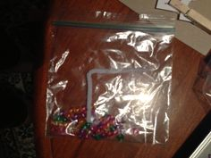 Busy bag - put beads on pipe cleaner in shape of target letter