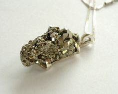 Handmade sterling silver and pyrite specimen pendant  MEASURES: 3,3 x 1,3 cm and 1,3 high Accompanied with the chain Every jewelry is sent A