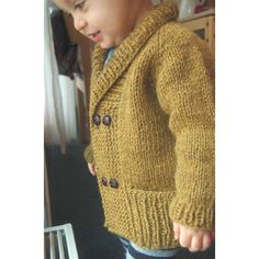 """Cozy yet elegant, comfy and warm, this is the perfect cardigan to snuggle up in at storytime. Just enough ribbing to be distinguished… and just enough garter stitch to be adorable! With subtle worked-in garter stitch elbow """"patches""""… A double-breasted front and cozy shawl collar…. And optional inset pockets hidden behind a wide ribbed hem to stash away treasures… A very fast and easy knit, this cardigan is worked from the top down seamlessly. The body is worked flat; the sleeves are worked…"""