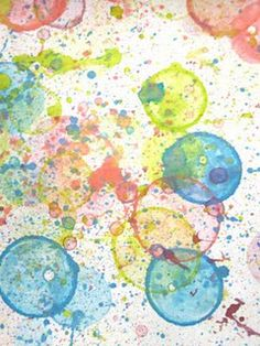 Pour kids bubbles into small containers.  Mixed a few drops of food coloring into the containers.  Add some dish soap for extra bubbles.  Blow bubbles on  paper.  When they pop, they leave splatters and circle prints.
