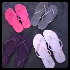 4 pair of Old Navy flip flops BUNDLE! Purple pair never worn. All other pairs only worn once or twice. Great deal!! Purple,Grey, Pink, and White pairs. Old Navy Shoes Sandals
