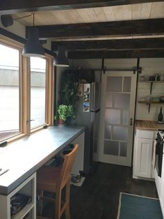 Desk/eating space and Fridge. Tanlers Tiny HouseNote, larger fridge and barn door to save space. Tiny House Living, Small Living, Home And Living, Tiny House On Wheels, Small House Plans, Contemporary Barn, Modern Barn, Large Fridge, Modern Sliding Doors