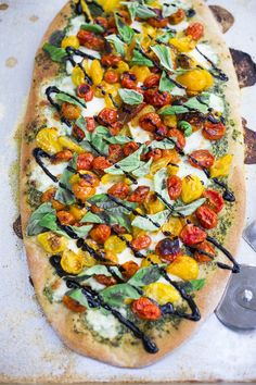 Delicious recipe for Caprese Pizza with heirloom tomatoes, fresh basil, fresh mozzarella cheese with a balsamic drizzle. Easy and flavorful!