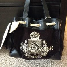 Juicy daydreamer black velour purse 100 percent authentic In excellent condition, only main sign of wear is on the bow which shows in the picture. This is a beautiful bag. I only used it a handful of times and it has just sat in my closet. Has many awesome pockets inside and comes from a pet free smoke free home.  Juicy Couture Bags
