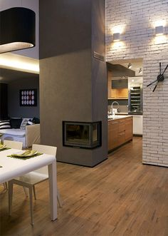 Actual fireplace seems too small, but like the look and use as a divider.  Also love the contrasting brick wall.
