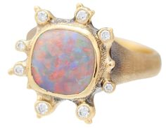 Ring in 18k yellow gold with 2.3 ct. Australian opal and 0.06 ct. t.w. diamonds, $3,800; Audrius Krulis