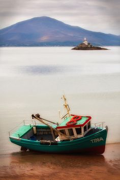 Fishing boat and Fenit Lighthouse. Situated within Tralee Bay, Fenit, Little Samphire Island Lighthouse