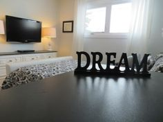 dresser-decor tv on wall above long dresser in bedroom decor With TV Abov Bedroom Tv Wall, Bedroom Dressers, Master Bedroom, Bedroom Decor, Bedroom Ideas, Iron Balusters, Banisters, Long Dresser, Tv Decor
