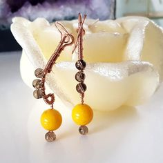 #women's #fashion #yellow #earrings  Fun and exciting long dangle handmade earrings.  Wire wrapped long dangle earrings in copper with a large 14 mm dyed stone hanging on the bottom. Grey transparent glass beads are wrapped in the body of the earrings creating a subtle sparkle with movement.  Wonderful pair of earrings, worn daily.