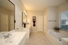 Serene master bathroom with huge window overlooking your private backyard oasis! #FirstMarketRealty #BrokerJodi #HoustonRealEstate