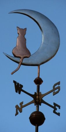 "What could be more appropriate than this serene nocturnal cat complementing the rising moon? While this weathervane can be made all copper or in a combination of copper and brass. With the optional gold or palladium leafing added to the moon, the contrast between the luminous ""moon glow"" and the distinctive silhouette of the copper cat …"