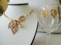 gold bead necklace with peridot, garnet, citrines, amethyst. leaf necklace earring. semiprecious stone necklaces. unique necklace. seed bead - pinned by pin4etsy.com
