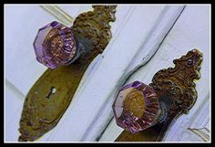 love that old glass turned purple from the sun...I am suddenly in love with old doorknobs.