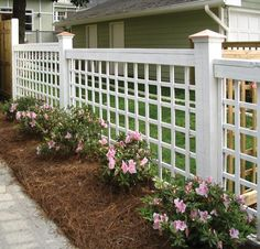 Atlanta Decking and Fence Company - Cumming, GA, United States. Lattice custom fence with copper post caps - designed and built by Atlanta Decking & Fence.